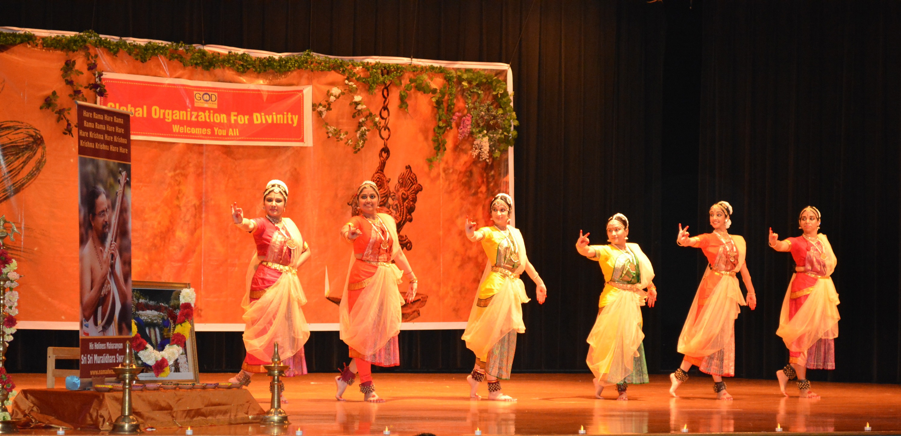 6 ballet dancers dance on stage in colorful garb